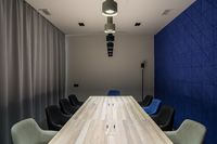 Stylish conference room with gray and blue walls