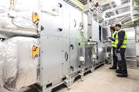 Workers in electrical switchgear room