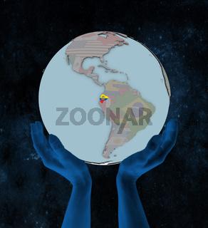 Ecuador on political globe in hands