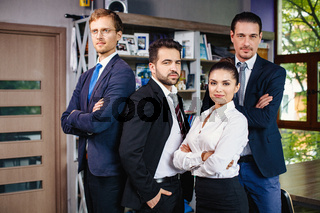 Successful young business people working as a team