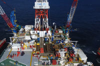 Oil offshore platform in the sea. Extraction of oil on the shelf