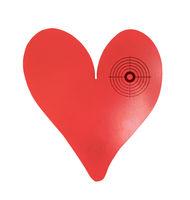 Target on a metal heart-shaped object