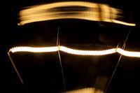 Tungsten filament in an incandescent lamp, macro photo.