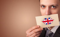 Person holding UK flag card