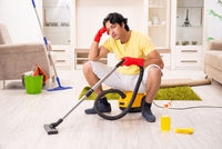Young handsome man doing housework