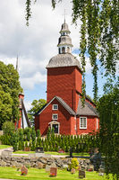 Red Rural Wooden Church in summer