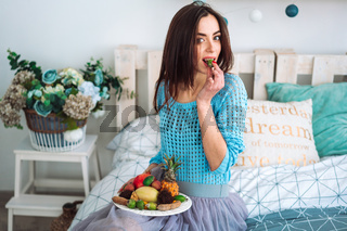 Girl holding the healthy fruit plate