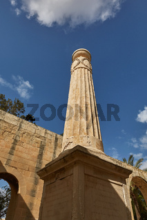 View of a pillar from lower viewpoint at upper Barrakka gardens in Valletta in Malta