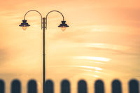Street lamp during orange sunset