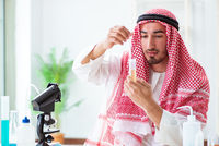 Arab chemist checking the quality of drinking water