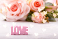 Pink roses with word LOVE