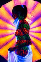 Woman with beautiful UV bodyart rearview