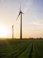 Windmill energy turbine at sunset
