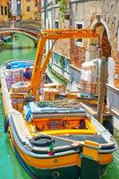 Discharging of freight boat in Venice