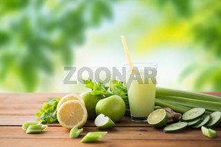 glass of green juice with fruits and vegetables