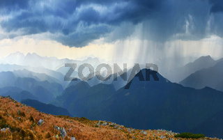 Downpour in spring mountains