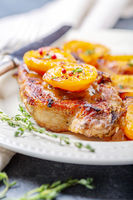 Juicy pork steak with apricots,thyme and potatoes.