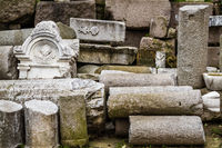 Ancient Carved Marble Parts Stacked in a Museum Backyard