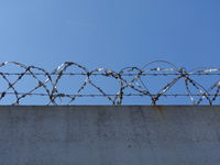 concrete wall with barbed wire