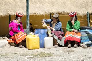 Indigenous women selling chicha (fermented corn beer) at the market in the Quechua community of Patacancha. October 21, 2012 - Patacancha, Ollantaytambo, Peru