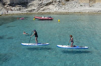 Female stand up paddlers clear turquoise water Mallorca
