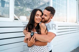 Handsome bearded man hugging his beautiful girl