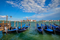 Gondolas and in lagoon of Venice by San Marco square. Venice, Italy