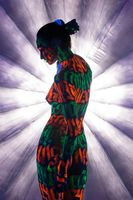 Girl with UV bodyart rearview