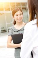Asian businesswomen outside office