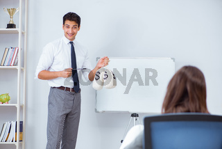 Businessman making presentation with money sacks