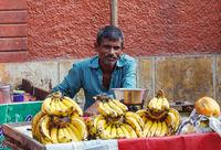 Indian man sells bananas