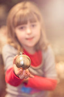 Cute girl holding Christmas decoration