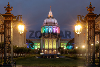 Dusk over San Francisco City Hall illuminated in rainbow colors for the Pride Festival.