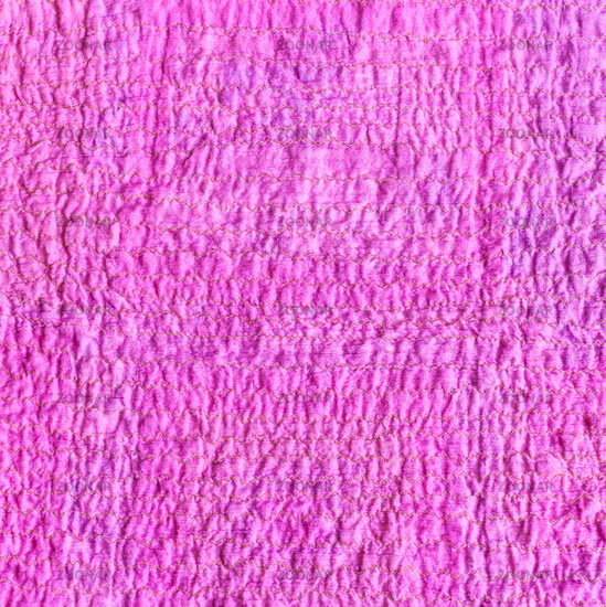 wrinkled surface of scarf from crushed pink fabric