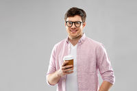 young man or student in glasses drinking coffee