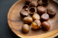 chestnuts on wooden plate
