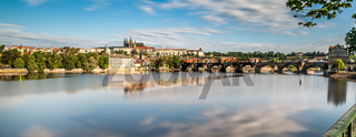 Panorama of Prague, reflection clouds on river Vltava