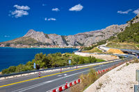 Scenic Dalamtian road by the sea in Omis view