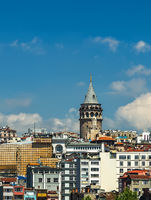 Cityscape summer sea front view with Galata Tower and Gulf of the Golden Horn in Istanbul, Turkey.