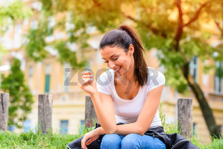 Portrait of a happy young woman being cheerful in a Park