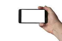A man hold a blank screen smartphone in the action of taking a selfie