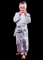 Little girl martial arts fighter isolated