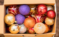 Colorful Christmas decorations in a cardboard box