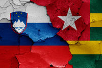 flags of Slovenia and Togo painted on cracked wall