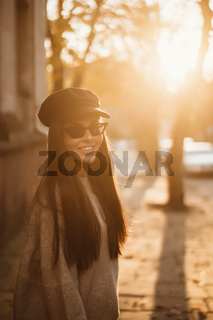 Street portrait of young beautiful fashionable woman