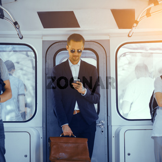 Businessman in metro train.