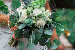 A bouquet of the bride from the living flowers of the rose, bride holds in his hand