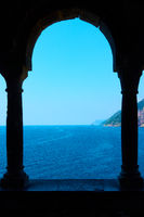 Sea through columns of Church of St. Peter in Porto Venere