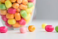 close up of colorful candy drops on table