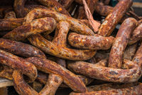 Pile of old heavy rusty chain links